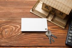 Real Estate Concept. Model house, keys, blank business card and calculator on - stock photo