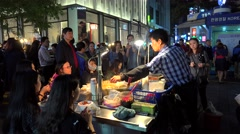 Street fast food booth with seafood at the Myeong-dong. Seoul, South Korea. Stock Footage