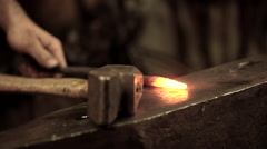 Ironworker forging hot iron in workshop Stock Footage