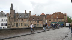 People walking on Dijver Canal's waterfront in Bruges Stock Footage