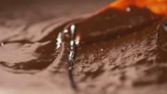 Stirring delicious melted chocolate with a knife in slow motion - stock footage