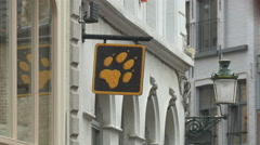 Stock Video Footage of Dog paw sign on the street in Bruges