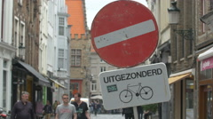 Bike parked near a restriction sign on Geldmuntstraat, Bruges Stock Footage