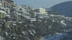 Old Bulgarian houses from the ancient city with snowy roofs in winter Stock Footage
