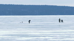 Fishermen on Ice at Frozen Lake in Winter Stock Footage