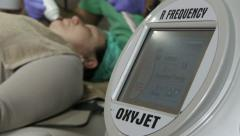 Beautician working with professional device for facial cleansing in beauty salon Stock Footage