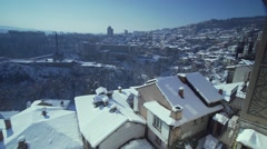 Panorama of Veliko Tarnovo with snowy roofs and rocks Stock Footage