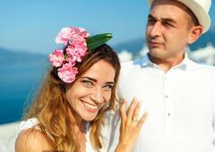 Attractive young couple walking alongside the marina - wedding concept Stock Photos