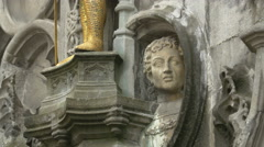View of a head sculpture on Basilica of the Holy Blood in Burg Square, Bruges Stock Footage