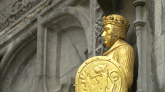 Golden soldier on Basilica of the Holy Blood in Burg Square, Bruges Stock Footage