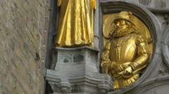 Golden bas-relief on Basilica of the Holy Blood in Burg Square, Bruges Stock Footage