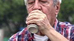 Senior Drinking Refreshing Beer Or Soda Stock Footage