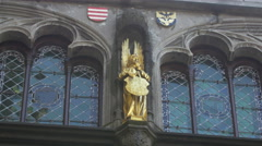Angel statue and coat of arms on Basilica of the Holy Blood in Bruges Stock Footage
