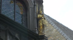 Golden angel on Basilica of the Holy Blood in Burg Square Stock Footage