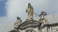 Three statues on top of a building in Burg Square, Bruges Stock Footage