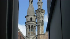 Basilica of the Holy Blood's towers seen in the afternoon in Bruges Stock Footage