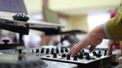 Hands of a DJ on mixing sound board, at a party 3c Stock Footage
