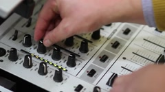 Hands of a DJ on mixing sound board, at a party 3b Stock Footage