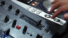 Hands of a DJ on mixing sound board, at a party 4a Stock Footage