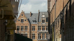The brick buildings of Market Square seen from Hallestraat in Bruges Stock Footage