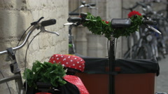 Two decorated bikes with red chairs and flowers in Bruges Stock Footage