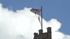 Bruges flag waving on the Provinciaal Hof's chimney Stock Footage