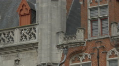 Tilt up view of the decorated Provinciaal Hof's spire in Bruges Stock Footage