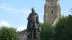 Bird standing on Simon Stevin statue in Bruges Stock Footage