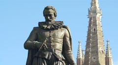 Simon Stevin statue with the Church of Our Lady in the background, Bruges Stock Footage