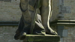 Tilt up view of a statue outside Saint Salvator's Cathedral in Bruges Stock Footage