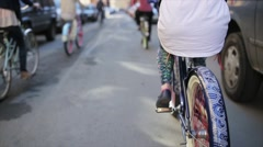 Back side of girl cycling  among other cycling people in summer day. Slow motion - stock footage