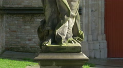 Tilt up view of a man statue outside Saint Salvator's Cathedral in Bruges Stock Footage