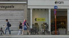 People walking along the Zuidzandstraat street shops in Bruges Stock Footage