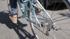 Back side of person cycling in summer day wheel of bicycle focus in. Slow motion Stock Footage