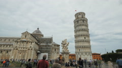 tourists admiring the famous leaning tower of pisa - stock footage