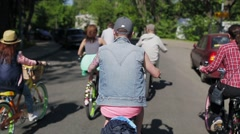 Back side of cycling group of people in summer day. Slow motion - stock footage