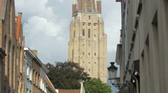 Tilt up view of the Church of Our Lady tower in Bruges Stock Footage