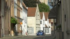 View of a blue car driving on Goezeputstraat in Bruges Stock Footage