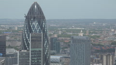 Aerial view 30 St. Mary Axe modern building central London Gherkin design day Stock Footage