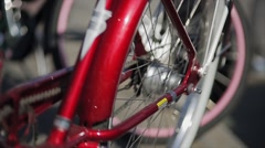 Back wheel and sit of a red bicycle focus in in summer sunny day. Close up Stock Footage