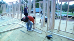 Construction Workers Framing New House Stock Footage
