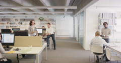 Sexy new woman walking into office interested men and nasty women looking slow - stock footage