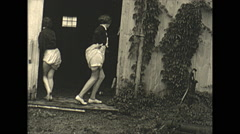 Vintage 16mm film, 1936, people, woman showing off undergarments from barn, - stock footage