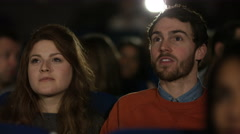 4K Young couple watching film in busy movie theatre. Audience puts on 3D glasses - stock footage