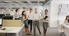 Embarrassed businessman walking into office naked diverse people looking with - stock footage