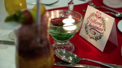 Christmas table setting with candles, celebration of Christmas Stock Footage