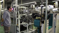 Clothing Engineer Oversees Garment Manufacture in a Factory Stock Footage