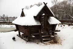 wooden building . winter season - stock photo
