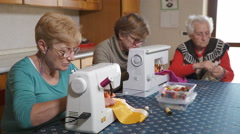 Two generations of women handmading their textile products, skill Stock Footage