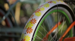 Swivel wheel of a colorful bicycle in summer sanny day. Pan vertical Stock Footage